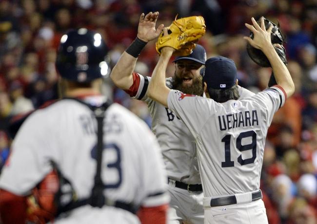 Oct 27, 2013; St. Louis, MO, USA; Boston Red Sox relief pitcher Koji Uehara (19) celebrates with first baseman Mike Napoli (middle) after game four of the MLB baseball World Series against the St. Louis Cardinals at Busch Stadium. Mandatory Credit: H.Darr Beiser-USA TODAY Sports