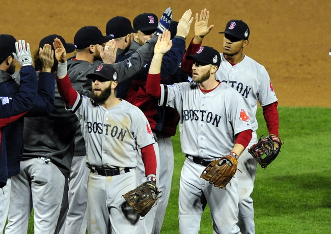 Oct 27, 2013; St. Louis, MO, USA; Boston Red Sox second baseman Dustin Pedroia (left) celebrates with teammates after defeating the St. Louis Cardinals in game four of the MLB baseball World Series at Busch Stadium. Red Sox won 4-2. Mandatory Credit: Jeff Curry-USA TODAY Sports