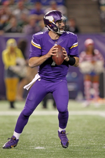 Oct 27, 2013; Minneapolis, MN, USA; Minnesota Vikings quarterback Christian Ponder (7) drops back to pass during the fourth quarter against the Green Bay Packers at Mall of America Field at H.H.H. Metrodome. The Packers defeated the Vikings 44-31. Mandatory Credit: Brace Hemmelgarn-USA TODAY Sports