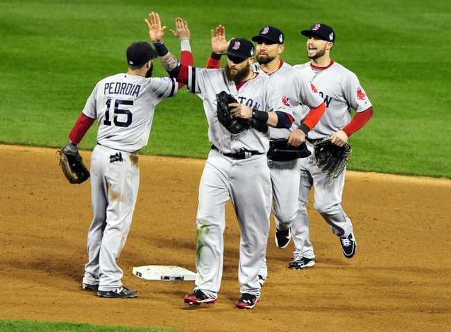 Oct 27, 2013; St. Louis, MO, USA; Boston Red Sox left fielder Jonny Gomes (center) celebrates with second baseman Dustin Pedroia (15) after defeating the St. Louis Cardinals in game four of the MLB baseball World Series at Busch Stadium. Red Sox won 4-2. Mandatory Credit: Jeff Curry-USA TODAY Sports