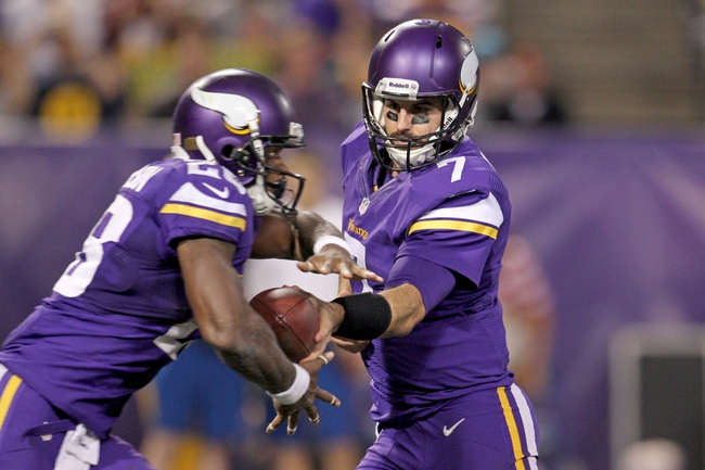 Oct 27, 2013; Minneapolis, MN, USA; Minnesota Vikings quarterback Christian Ponder (7) gads the ball off to running back Adrian Peterson (28) during the fourth quarter against the Green Bay Packers at Mall of America Field at H.H.H. Metrodome. The Packers defeated the Vikings 44-31. Mandatory Credit: Brace Hemmelgarn-USA TODAY Sports