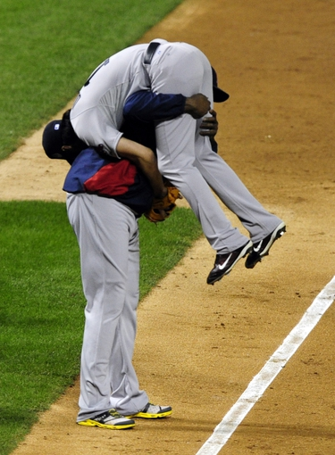 Oct 27, 2013; St. Louis, MO, USA; Boston Red Sox first baseman David Ortiz (left) picks up relief pitcher Koji Uehara (right) after defeating the St. Louis Cardinals in game four of the MLB baseball World Series at Busch Stadium. Red Sox won 4-2. Mandatory Credit: Jeff Curry-USA TODAY Sports