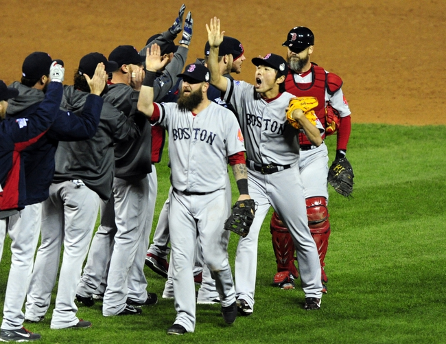 Oct 27, 2013; St. Louis, MO, USA; Boston Red Sox first baseman Mike Napoli (center) celebrates with teammates after defeating the St. Louis Cardinals in game four of the MLB baseball World Series at Busch Stadium. Red Sox won 4-2. Mandatory Credit: Jeff Curry-USA TODAY Sports