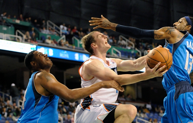 Oct 19, 2013; Greensboro, NC, USA; Charlotte Bobcats forward Cody Zeller (40) drives to the basket during the game against the Dallas Mavericks at the Greensboro Coliseum. Mavericks win 89-83. Mandatory Credit: Sam Sharpe-USA TODAY Sports
