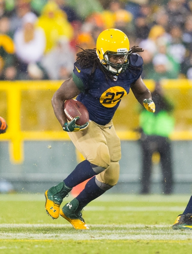 Oct 20, 2013; Green Bay, WI, USA; Green Bay Packers running back Eddie Lacy (27) during the game against the Cleveland Browns at Lambeau Field.  Green Bay won 31-13.  Mandatory Credit: Jeff Hanisch-USA TODAY Sports