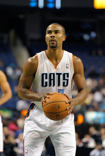 Oct 19, 2013; Greensboro, NC, USA; Charlotte Bobcats guard Ramon Sessions (7) shoots a foul shot during the game against the Dallas Mavericks at the Greensboro Coliseum. Mavericks win 89-83. Mandatory Credit: Sam Sharpe-USA TODAY Sports