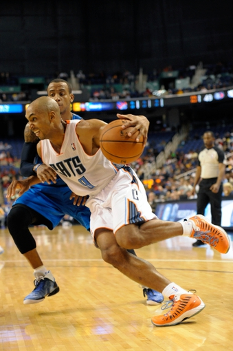 Oct 19, 2013; Greensboro, NC, USA; Charlotte Bobcats guard Gerald Henderson (9) drives to the basket past Dallas Mavericks guard Monta Ellis (11) during the game at the Greensboro Coliseum. Mavericks win 89-83. Mandatory Credit: Sam Sharpe-USA TODAY Sports