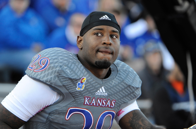 Oct 19, 2013; Lawrence, KS, USA; Kansas Jayhawks running back James Sims (29) on the sidelines against the Oklahoma Sooners in the second half at Memorial Stadium. Oklahoma won the game 34-19. Mandatory Credit: John Rieger-USA TODAY Sports