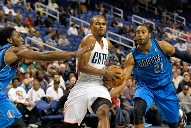Oct 19, 2013; Greensboro, NC, USA; Charlotte Bobcats guard Ramon Sessions (7) drives past Dallas Mavericks forward Jae Crowder (left) and guard Wayne Ellington (21) during the game at the Greensboro Coliseum. Mavericks win 89-83. Mandatory Credit: Sam Sharpe-USA TODAY Sports