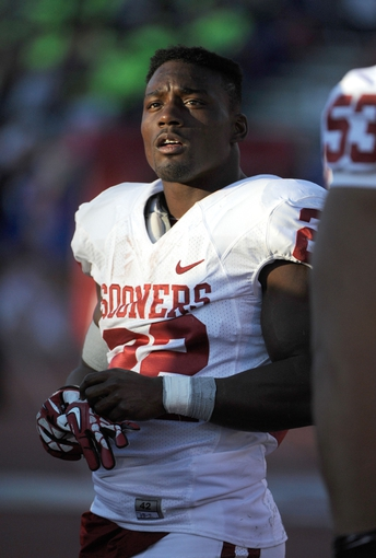 Oct 19, 2013; Lawrence, KS, USA; Oklahoma Sooners running back Roy Finch (22) on the sidelines against the Kansas Jayhawks in the second half at Memorial Stadium. Oklahoma won the game 34-19. Mandatory Credit: John Rieger-USA TODAY Sports