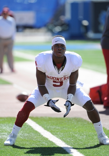 Oct 19, 2013; Lawrence, KS, USA; Oklahoma Sooners wide receiver Durron Neal (5) warms up before the game against the Kansas Jayhawks at Memorial Stadium. Oklahoma won the game 34-19. Mandatory Credit: John Rieger-USA TODAY Sports