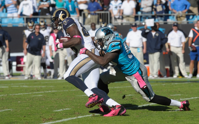 Oct 20, 2013; Charlotte, NC, USA; St. Louis Rams tight end Jared Cook (89) breaks the tackle of Carolina Panthers line backer Thomas Davis (59) during the game at Bank of America Stadium. Panthers win 30-15. Mandatory Credit: Sam Sharpe-USA TODAY Sports