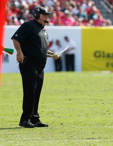 Oct 13, 2013; Tampa, FL, USA; Philadelphia Eagles head coach Chip Kelly looks on against the Tampa Bay Buccaneers during the second half at Raymond James Stadium. Philadelphia Eagles defeated the Tampa Bay Buccaneers 31-20. Mandatory Credit: Kim Klement-USA TODAY Sports