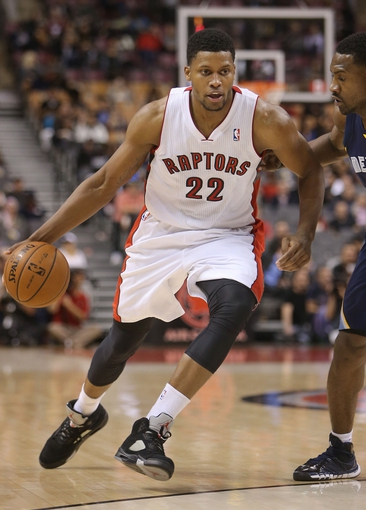 Oct 23, 2013; Toronto, Ontario, CAN; Toronto Raptors forward Rudy Gay (22) dribbles against the Memphis Grizzlies at Air Canada Centre. The Raptors beat the Grizzlies 108-72. Mandatory Credit: Tom Szczerbowski-USA TODAY Sports