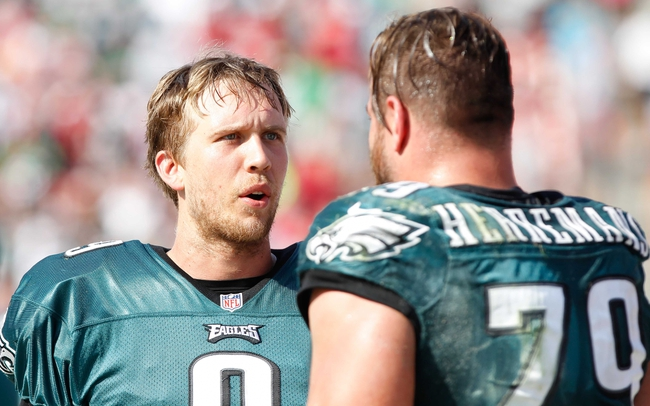 Oct 13, 2013; Tampa, FL, USA; Philadelphia Eagles quarterback Nick Foles (9) talks with guard Todd Herremans (79) against the Tampa Bay Buccaneers during the second half at Raymond James Stadium. Philadelphia Eagles defeated the Tampa Bay Buccaneers 31-20. Mandatory Credit: Kim Klement-USA TODAY Sports