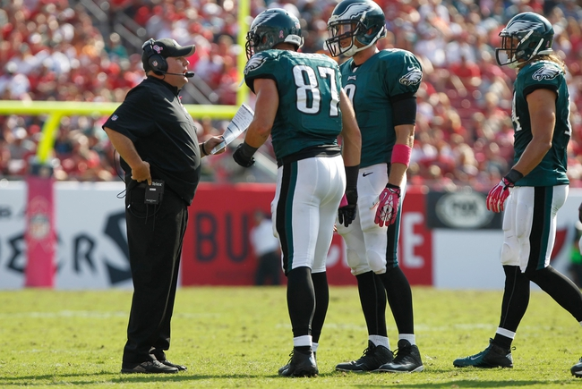 Oct 13, 2013; Tampa, FL, USA; Philadelphia Eagles head coach Chip Kelly talks with tight end Brent Celek (87) and quarterback Nick Foles (9) against the Tampa Bay Buccaneers  during the second half at Raymond James Stadium. Philadelphia Eagles defeated the Tampa Bay Buccaneers 31-20. Mandatory Credit: Kim Klement-USA TODAY Sports