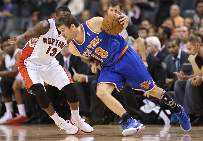 Oct 11, 2013; Toronto, Ontario, CAN; New York Knicks guard Beno Udrih (18) makes a move against Toronto Raptors guard Dwight Buycks (13) at Air Canada Centre. The Raptors beat the Knicks 100-91. Mandatory Credit: Tom Szczerbowski-USA TODAY Sports