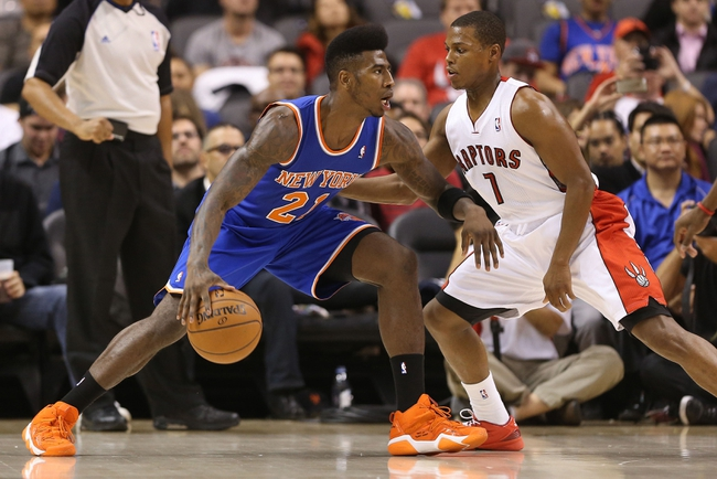 Oct 11, 2013; Toronto, Ontario, CAN; New York Knicks guard Iman Shumpert (21) looks to get past Toronto Raptors point guard Kyle Lowry (7) at Air Canada Centre. The Raptors beat the Knicks 100-91. Mandatory Credit: Tom Szczerbowski-USA TODAY Sports