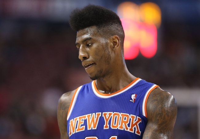 Oct 11, 2013; Toronto, Ontario, CAN; New York Knicks guard Iman Shumpert (21) against the Toronto Raptors at Air Canada Centre. The Raptors beat the Knicks 100-91. Mandatory Credit: Tom Szczerbowski-USA TODAY Sports