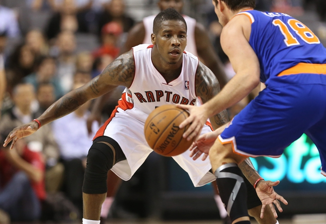 Oct 11, 2013; Toronto, Ontario, CAN; Toronto Raptors guard Dwight Buycks (13) defends against New York Knicks point guard Beno Udrih (18) at Air Canada Centre. The Raptors beat the Knicks 100-91. Mandatory Credit: Tom Szczerbowski-USA TODAY Sports