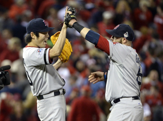 Oct 28, 2013; St. Louis, MO, USA; Boston Red Sox relief pitcher Koji Uehara (left) celebrates with left fielder Jonny Gomes (5) after game five of the MLB baseball World Series against the St. Louis Cardinals at Busch Stadium. Mandatory Credit: H.Darr Beiser-USA TODAY Sports