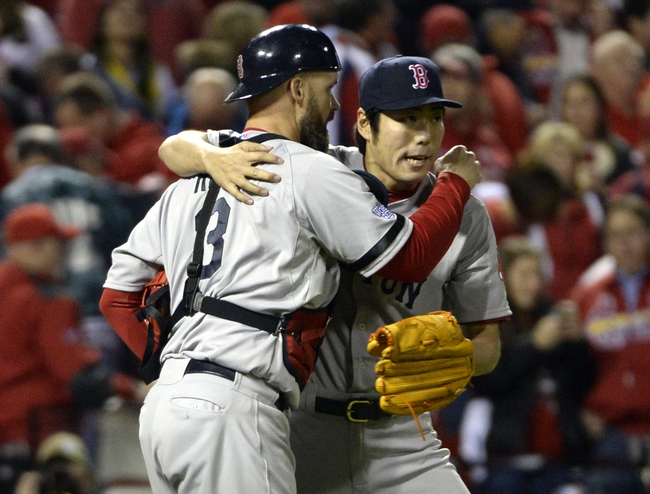 Oct 28, 2013; St. Louis, MO, USA; Boston Red Sox relief pitcher Koji Uehara (right) is congratulated by catcher David Ross (3) after game five of the MLB baseball World Series against the St. Louis Cardinals at Busch Stadium. Mandatory Credit: H.Darr Beiser-USA TODAY Sports