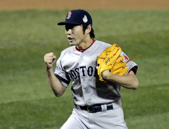 Oct 28, 2013; St. Louis, MO, USA; Boston Red Sox relief pitcher Koji Uehara celebrates after game five of the MLB baseball World Series against the St. Louis Cardinals at Busch Stadium. Mandatory Credit: Eileen Blass-USA TODAY Sports