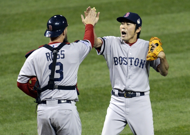 Oct 28, 2013; St. Louis, MO, USA; Boston Red Sox relief pitcher Koji Uehara (right) celebrates with right fielder Carlos Beltran (3) after game five of the MLB baseball World Series against the St. Louis Cardinals at Busch Stadium. Mandatory Credit: Eileen Blass-USA TODAY Sports