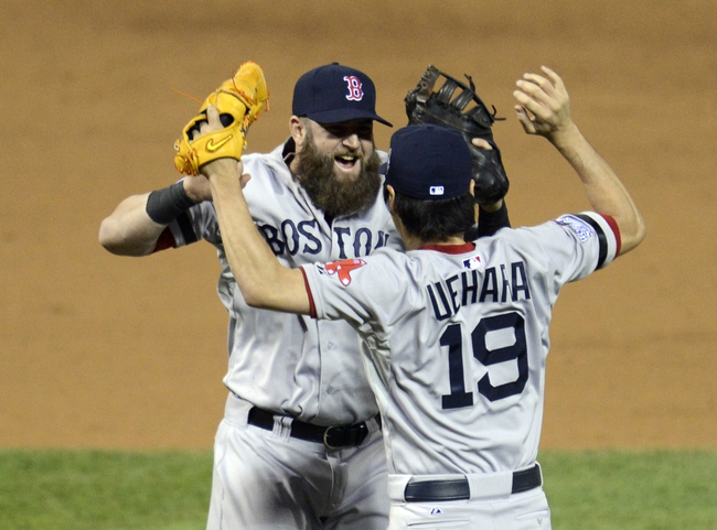 Oct 28, 2013; St. Louis, MO, USA; Boston Red Sox relief pitcher Koji Uehara (19) celebrates with first baseman Mike Napoli (left) after game five of the MLB baseball World Series against the St. Louis Cardinals at Busch Stadium. Mandatory Credit: Eileen Blass-USA TODAY Sports