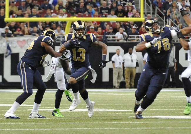 Oct 28, 2013; St. Louis, MO, USA; St. Louis Rams wide receiver Chris Givens (13) runs the gal against the Seattle Seahawks during the second half at Edward Jones Dome. The Seahawks defeat the Rams 14-9. Mandatory Credit: Jasen Vinlove-USA TODAY Sports