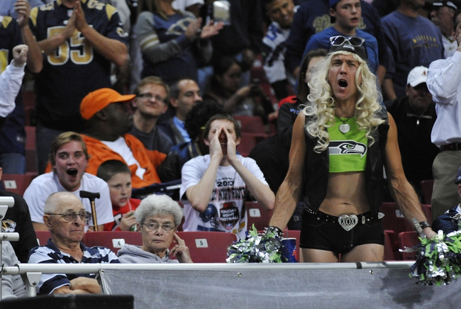 Oct 28, 2013; St. Louis, MO, USA; A fan of the Seattle Seahawks cheers during the second half at Edward Jones Dome. The Seahawks defeat the Rams 14-9. Mandatory Credit: Jasen Vinlove-USA TODAY Sports