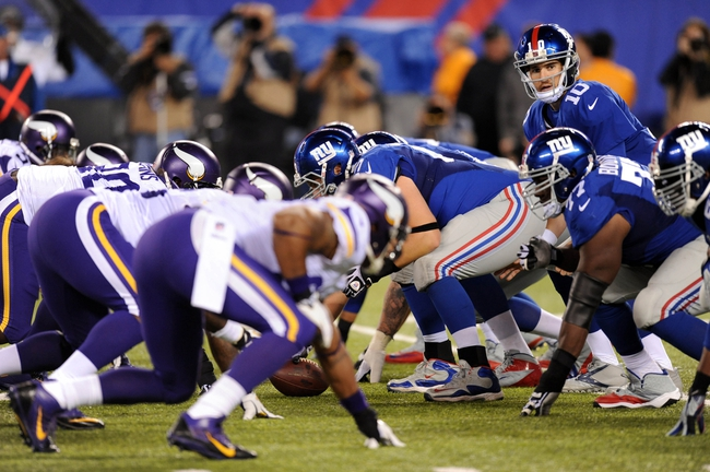 Oct 21, 2013; East Rutherford, NJ, USA; New York Giants quarterback Eli Manning (10) calls signals at the line of scrimmage against the Minnesota Vikings at MetLife Stadium. The Giants won the game 23-7. Mandatory Credit: Joe Camporeale-USA TODAY Sports