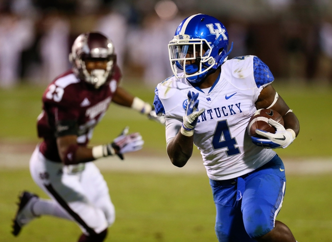 Oct 24, 2013; Starkville, MS, USA; Kentucky Wildcats running back Raymond Sanders (4) advances the ball during the game against the Mississippi State Bulldogs at Davis Wade Stadium. Mississippi State Bulldogs win the game against Kentucky Wildcats 28-22.  Mandatory Credit: Spruce Derden-USA TODAY Sports