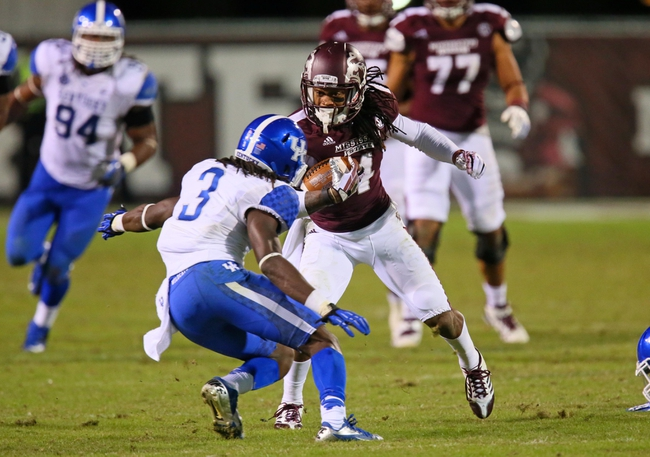 Oct 24, 2013; Starkville, MS, USA; Mississippi State Bulldogs wide receiver Jameon Lewis (4) runs the ball against Kentucky Wildcats cornerback Fred Tiller (3) during the game at Davis Wade Stadium. Mississippi State Bulldogs win the game against Kentucky Wildcats 28-22.  Mandatory Credit: Spruce Derden-USA TODAY Sports