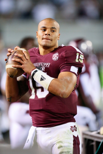 Oct 24, 2013; Starkville, MS, USA; Mississippi State Bulldogs quarterback Dak Prescott (15) on the sidelines during the game against the Kentucky Wildcats at Davis Wade Stadium. Mississippi State Bulldogs win the game against Kentucky Wildcats 28-22.  Mandatory Credit: Spruce Derden-USA TODAY Sports