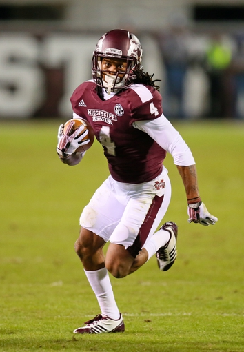 Oct 24, 2013; Starkville, MS, USA; Mississippi State Bulldogs wide receiver Jameon Lewis (4) advances the ball during the game against the Kentucky Wildcats at Davis Wade Stadium. Mississippi State Bulldogs win the game against Kentucky Wildcats 28-22.  Mandatory Credit: Spruce Derden-USA TODAY Sports