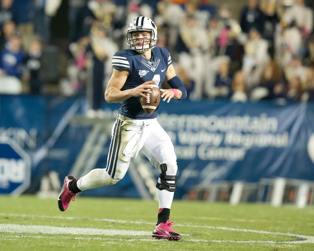 Oct 25, 2013; Provo, UT, USA; Brigham Young Cougars quarterback Taysom Hill (4) rolls out during the second half against the Boise State Broncos at Lavell Edwards Stadium. Brigham Young won 37-20. Mandatory Credit: Russ Isabella-USA TODAY Sports