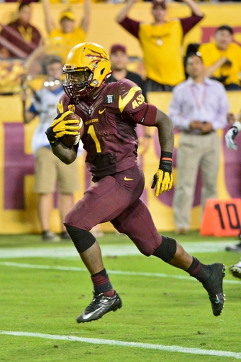 Oct 19, 2013; Tempe, AZ, USA; Arizona State Sun Devils running back Marion Grice (1) during the game against the Washington Huskies at Sun Devil Stadium. Mandatory Credit: Matt Kartozian-USA TODAY Sports