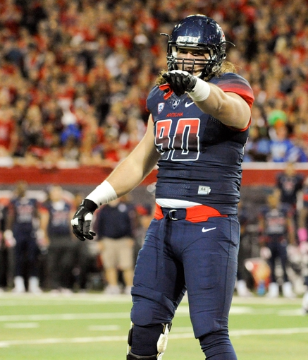 Oct 19, 2013; Tucson, AZ, USA; Arizona Wildcats defensive lineman Dan Pettinato (90) in between plays during the fourth quarter against the Utah Utes at Arizona Stadium. Arizona beat Utah 35-44. Mandatory Credit: Casey Sapio-USA TODAY Sports