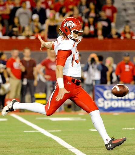 Oct 19, 2013; Tucson, AZ, USA; Utah Utes punter Tom Hackett (33) punts the ball during the third quarter against the Arizona Wildcats at Arizona Stadium. Arizona beat Utah 35-44. Mandatory Credit: Casey Sapio-USA TODAY Sports