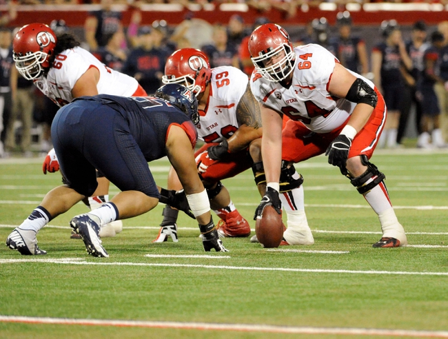 Oct 19, 2013; Tucson, AZ, USA; Utah Utes offensive lineman Vyncent Jones (64) prepares to snap the ball during the fourth quarter against the Arizona Wildcats at Arizona Stadium. Arizona beat Utah 35-44. Mandatory Credit: Casey Sapio-USA TODAY Sports