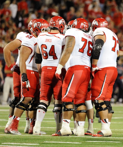 Oct 19, 2013; Tucson, AZ, USA; Utah Utes offensive lineman Junior Salt (59) offensive lineman Vyncent Jones (64) offensive lineman Jeremiah Tofaeono (76) and offensive lineman Jeremiah Poutasi (73) huddle up during the fourth quarter against the Arizona Wildcats at Arizona Stadium. Arizona beat Utah 35-44. Mandatory Credit: Casey Sapio-USA TODAY Sports