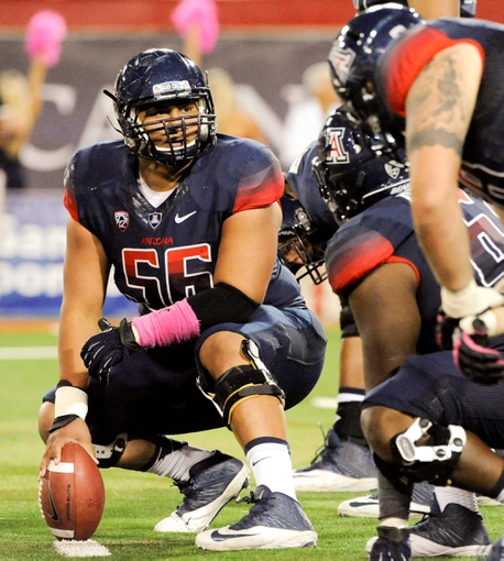 Oct 19, 2013; Tucson, AZ, USA; Arizona Wildcats offensive lineman Steven Gurrola (56) in between plays during the third quarter against the Utah Utes at Arizona Stadium. Arizona beat Utah 35-44. Mandatory Credit: Casey Sapio-USA TODAY Sports