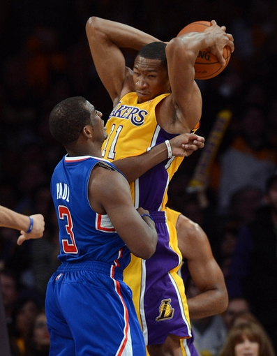 Oct 29, 2013; Los Angeles, CA, USA;Los Angeles Lakers shooting guard Wesley Johnson (11) grabs a rebound in front of Los Angeles Clippers point guard Chris Paul (3) in the second half of the game at Staples Center. Lakers won 116-103. Mandatory Credit: Jayne Kamin-Oncea-USA TODAY Sports