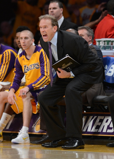Oct 29, 2013; Los Angeles, CA, USA; Los Angeles Lakers assistant coach Kurt Rambis reacts watching game action in the second half of the game against the Los Angeles Lakers at the at Staples Center. Lakers won 116-103. Mandatory Credit: Jayne Kamin-Oncea-USA TODAY Sports