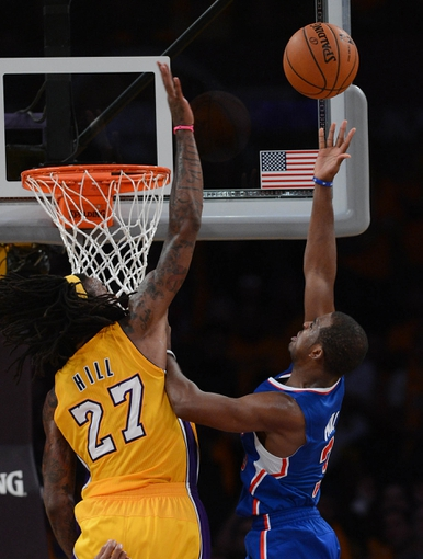 Oct 29, 2013; Los Angeles, CA, USA; Los Angeles Lakers center Jordan Hill (27) blocks a shot by Los Angeles Clippers point guard Chris Paul (3) in the second of the game at Staples Center. Lakers won 116-103. Mandatory Credit: Jayne Kamin-Oncea-USA TODAY Sports