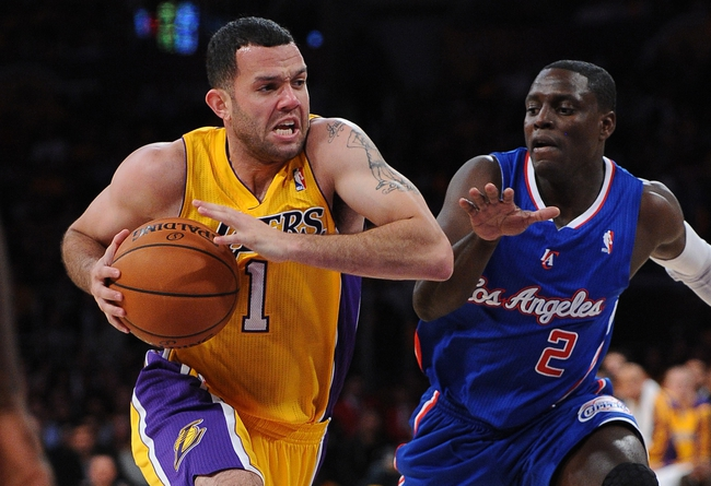 Oct 29, 2013; Los Angeles, CA, USA;   Los Angeles Clippers point guard Darren Collison (2) guards Los Angeles Lakers point guard Jordan Farmar (1) in the second half of the game at the Staples Center. Lakers won 116-103. Mandatory Credit: Jayne Kamin-Oncea-USA TODAY Sports
