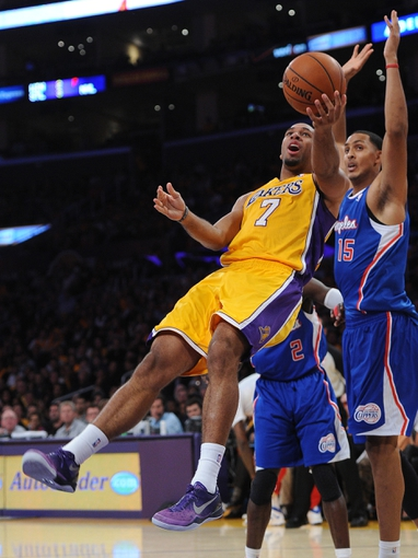Oct 29, 2013; Los Angeles, CA, USA;   Los Angeles Lakers shooting guard Xavier Henry (7) scores a basket as he is fouled by Los Angeles Clippers center Ryan Hollins (15) in the second half of the game at the Staples Center. Lakers won 116-103. Mandatory Credit: Jayne Kamin-Oncea-USA TODAY Sports
