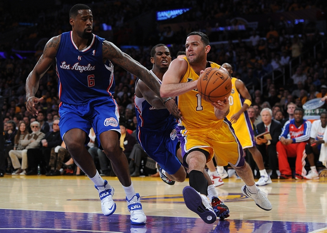 Oct 29, 2013; Los Angeles, CA, USA;   Los Angeles Clippers center DeAndre Jordan (6) guards Los Angeles Lakers point guard Jordan Farmar (1) in the second half of the game at the Staples Center. Lakers won 116-103. Mandatory Credit: Jayne Kamin-Oncea-USA TODAY Sports