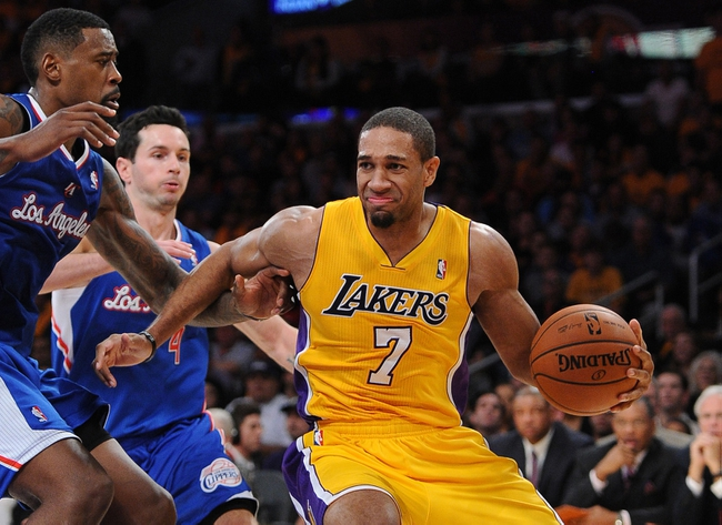 Oct 29, 2013; Los Angeles, CA, USA;   Los Angeles Clippers center DeAndre Jordan (6) guards Los Angeles Lakers shooting guard Xavier Henry (7) in the second half of the game at the Staples Center. Lakers won 116-103. Mandatory Credit: Jayne Kamin-Oncea-USA TODAY Sports